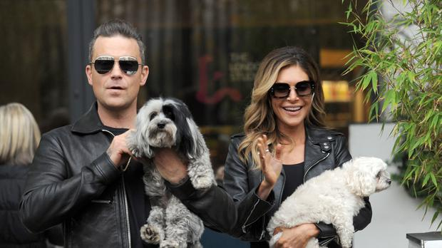 Robbie Williams and his wife Ayda Field are reportedly set to become judges on The X Factor (Nick Ansell/PA)