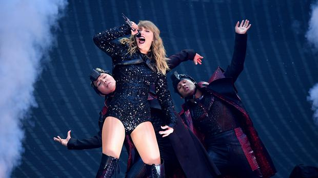 Taylor Swift performing on stage at Wembley Stadium (Ian West/PA)