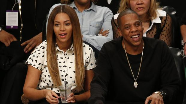 Jaz-Z and Beyonce will play the festival (Jonathan Brady/PA)