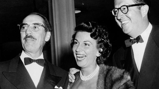 Nancy Sinatra, wife of actor and singer Frank Sinatra, with comedians Groucho Marx and Phil Silvers at a Hollywood party (PA)