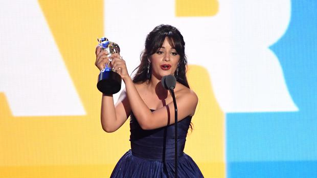Camila Cabello accepts the award for artist of the year (PA)
