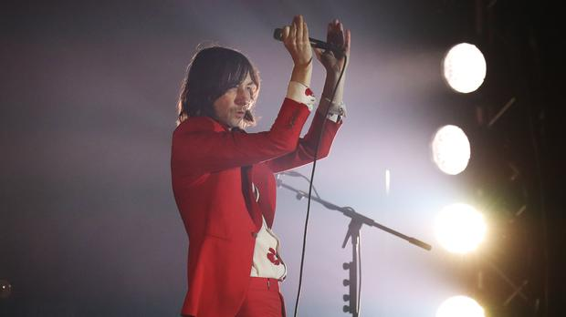 Lead singer of Primal Scream Bobby Gillespie performs at Slessor Gardens in Dundee (Andrew Milligan/PA)