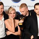 Wolf Alice celebrate winning the 2018 Hyundai Mercury Music Prize (Ian West/PA)