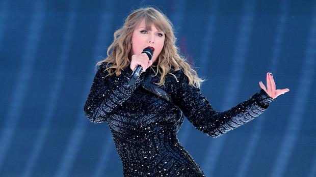 Taylor Swift opened the American Music Awards with her first awards show performance in nearly three years (Ian West/PA)
