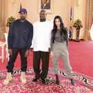 Kanye West and his wife Kim Kardashian West with Uganda's President Yoweri Museveni (Presidential Press Unit/AP)