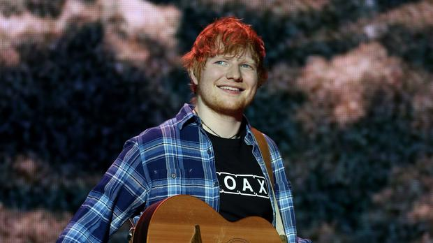 Ed Sheeran is leading a surge in UK music (Isabel Infantes/PA)