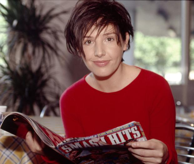 Read all about it: Sharleen Spiteri reads a copy of Smash Hits backstage at a TV show in 1999. Picture: David Tonge/Getty Images