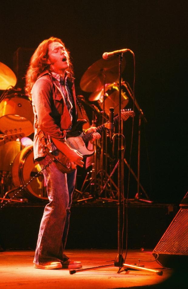 Guitar mastery: Gallagher in action in Manchester in the late 1970s Picture by Steve Smith