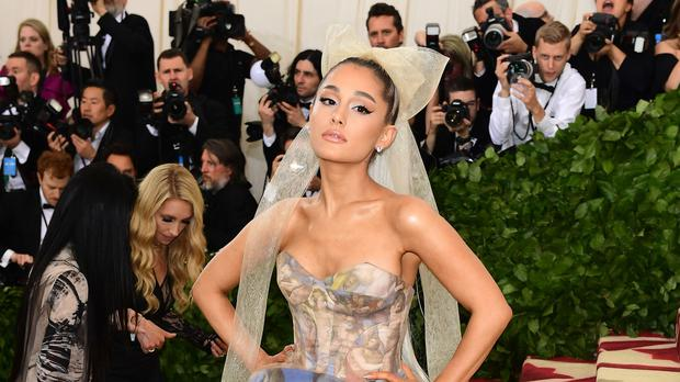 Ariana Grande has scored her first solo UK number one single (Ian West/PA)