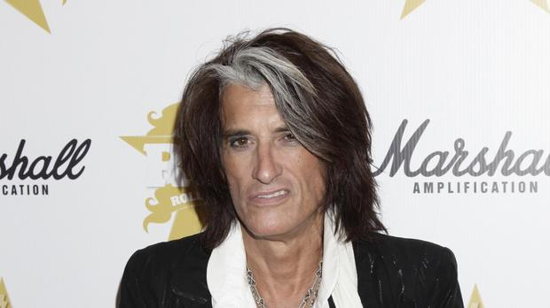Joe Perry had felt short of breath on stage (Yui Mok/PA)