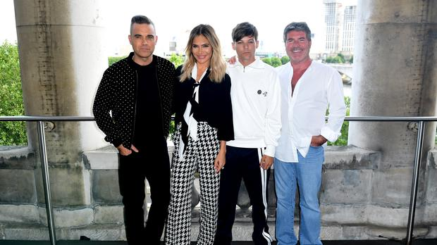 X Factor judges Robbie Williams, Ayda Field, Louis Tomlinson and Simon Cowell (Ian West/PA)
