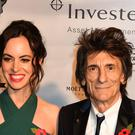 Ronnie Wood and his wife Sally Humphreys (John Stillwell/PA)