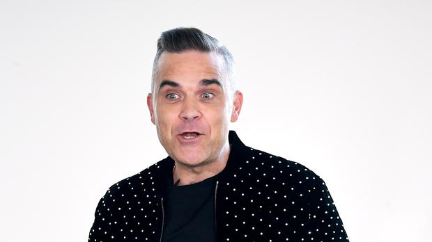 Robbie Williams' plans for a swimming pool at his home have been conditionally approved (Ian West/PA)