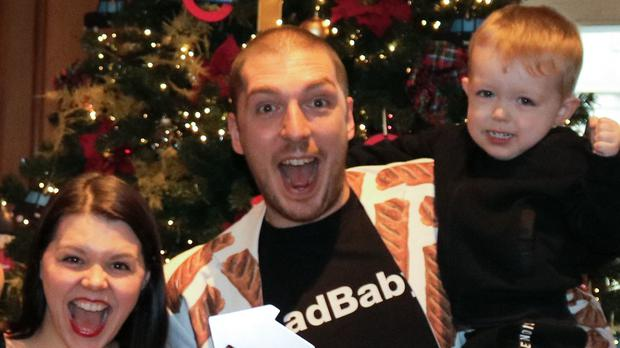 LadBaby, his wife Roxanne and their two sons, celebrating his Christmas number one (OfficialChart.com/PA)
