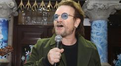 Bono urged people to dig deep into their pockets and bring hope to the homeless as he led a Christmas Eve busk in Dublin city centre (Lorraine O'Sullivan/PA).
