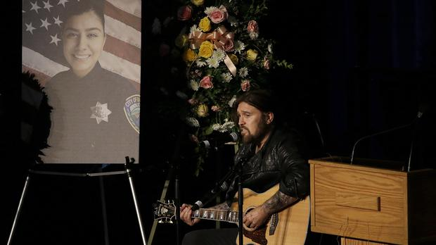 Musician Billy Ray Cyrus performs a song during funeral services for Davis Police Officer Natalie Corona (Rich Pedroncelli/AP)