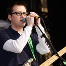 Weezer singer Rivers Cuomo performing on the main stage at the Carling Weekend music festival in Reading.