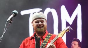 Tom Walker on stage (Isabel Infantes/PA)
