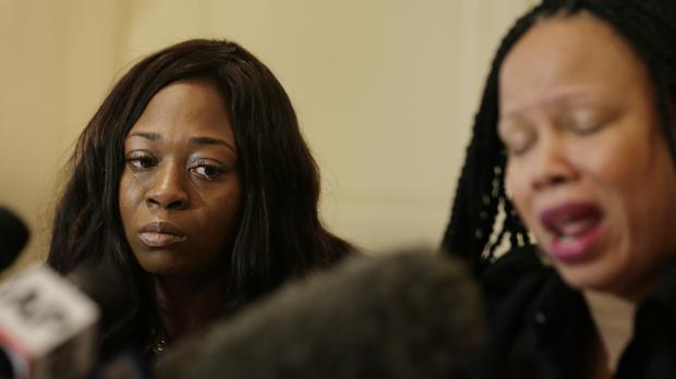Rochelle Washington, left, cries as Latresa Scaff details their sexual misconduct accusations (Seth Wenig/AP)
