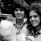 Marie Osmond with her brother Donny relaxing with candy floss in their younger days (PA)