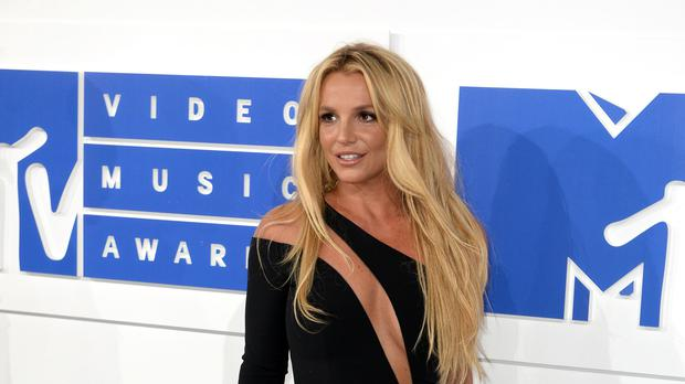Britney Spears posted an image on Instagram with the words, 'Fall in love with taking care of yourself' (PA/PA File)