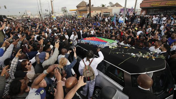 A hearse carrying the coffin of Nipsey Hussle passes through Los Angeles (Jae C Hong/AP)