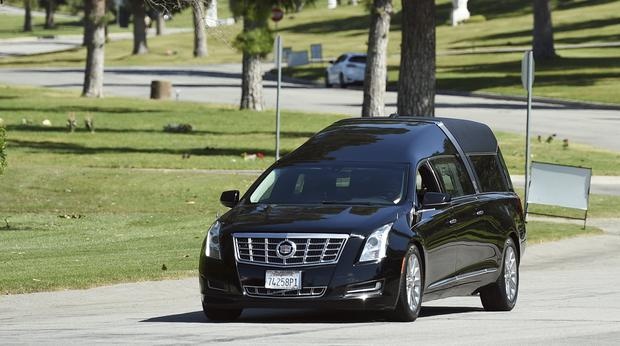 A hearse leaves a burial service for the late rapper Nipsey Hussle at Forest Lawn Hollywood Hills cemetery (Photo by Chris Pizzello/Invision/AP)