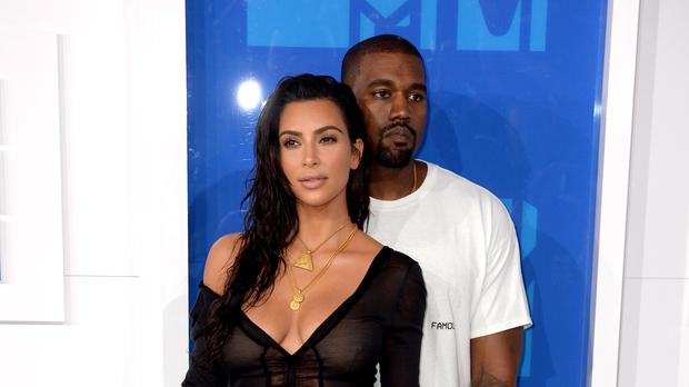 Kim Kardashian and Kanye West (PA)