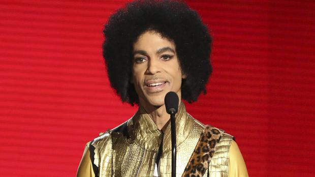 "FILE – In this Nov. 22, 2015, file photo, Prince presents the award for favorite album – Soul/RandB at the American Music Awards in Los Angeles. The memoir Prince was working on at the time of his death, ""The Beautiful Ones,"" is due out in late October 2019. (Photo by Matt Sayles/Invision/AP, File)"