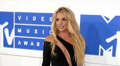Britney Spears promised to be 'back very soon' as she moved to reassure fans concerned over her well-being (PA)