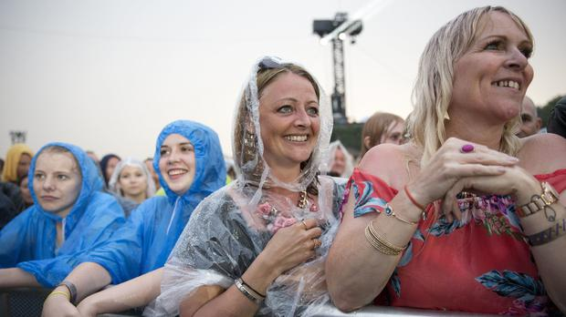 Michael Buble fans in the rain during his performance at the British Summer Time festival in London's Hyde Park in 2018 (Isabel Infantes/PA)