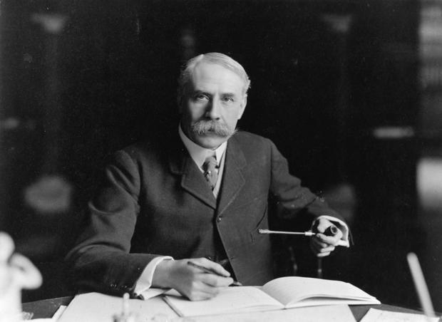 British composer Edward Elgar (1857 - 1934) seated at his desk at Severn House in Hampstead