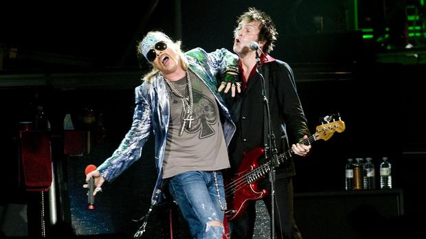 Axl Rose and Tommy Stinson of Guns N' Roses (Ian West/PA)