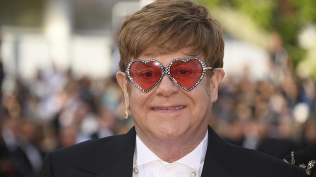 Sir Elton John poses for photographers upon arrival at the premiere of Rocketman (Arthur Mola/Invision/AP)