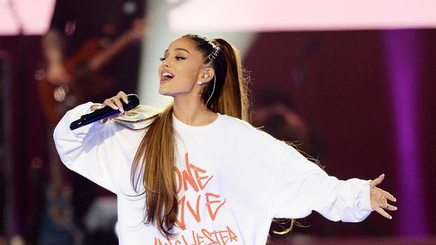 Ariana Grande has revealed the reason she was forced to postpone two concerts through illness was because of a tomato allergy (Dave Hogan for One Love Manchest/PA)