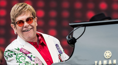 Piano man: Elton John is back at the top with a biographic film and sell-out tour. Photo: Getty Images