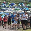 Glastonbury festival-goers going for a morning run (Yui Mok/PA)