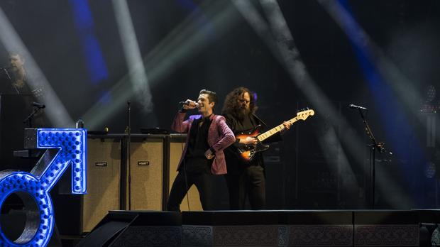 The Killers got their headline slot at Glastonbury off to an energetic start, beginning with two of their best known songs (David Jensen/PA)