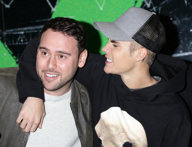Scooter Braun (left) and Justin Bieber in 2015 ( Yui Mok/PA)