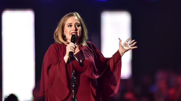 Adele was pictured with a mystery man at the British Summer Time festival (Dominic Lipinski/PA)