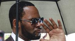 Musician R Kelly departs from the Leighton Criminal Court building (Amr Alfiky/AP)
