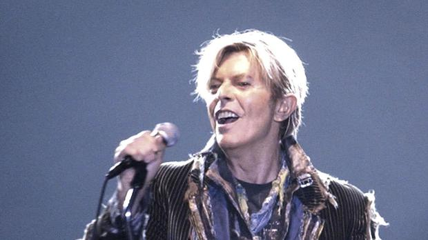 David Bowie on stage (PA)