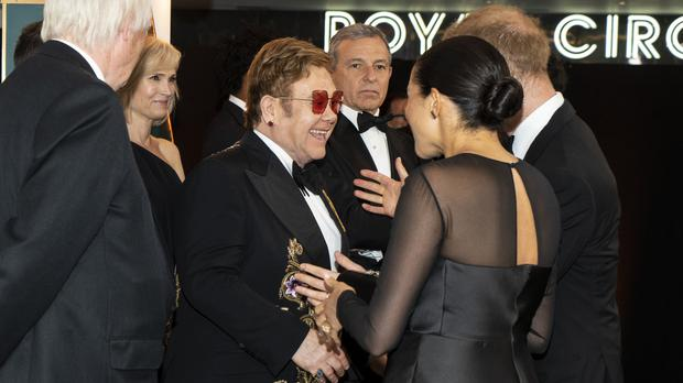 The Duke and Duchess of Sussex speak with Elton John (Niklas Halle'n/PA)