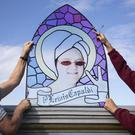 Centre manager Peter Law (right) and his assistant Malcolm Moore take a closer look at a stained glass window that features Scottish singer-songwriter Lewis Capaldi (Jane Barlow/PA)