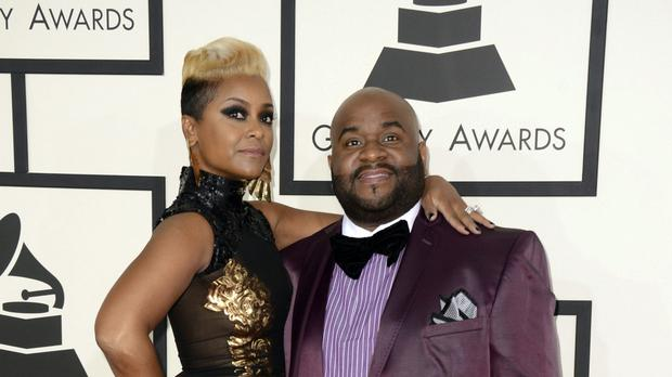 Tributes have been paid to Grammy Award-winning songwriter LaShawn Daniels, pictured with his wife April, after his death at the age of 41 (Jordan Strauss/Invision/AP, File)