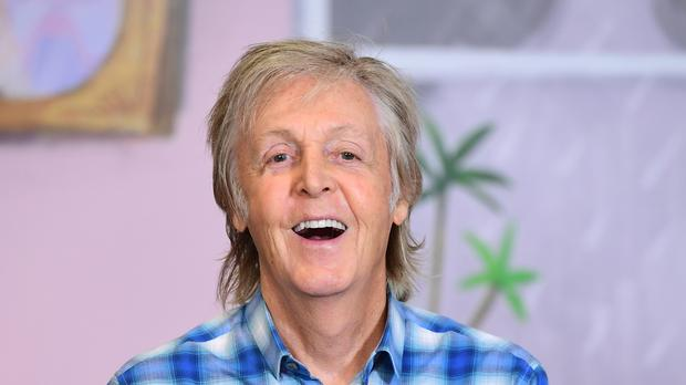Sir Paul McCartney met with school pupils (Ian West/PA)