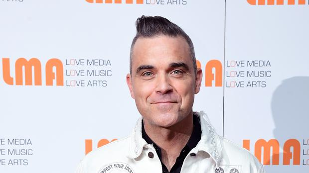 Robbie Williams has more plans for Christmas (Ian West/PA)