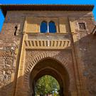 A postcard of the Alhambra arch Puerta del vino in Granada, Spain inspired Debussy