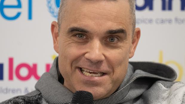 Robbie Williams, speaks during a press conference (Joe Giddens/PA)