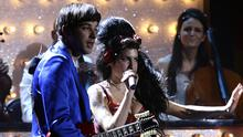 Amy Winehouse and Mark Ronson performing at the Brit Awards in 2008